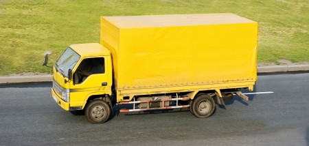 wheeler: yellow blank delivery  truck  Stock Photo