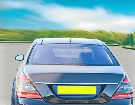 Car driving a vast road photo