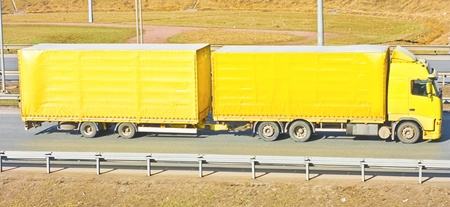 Yellow truck on a road photo