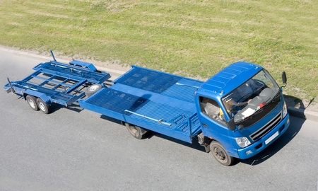 tow: wreck car carrier truck deliver damaged car to repair box.