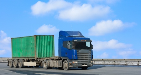 haulage: blue truck moves green container