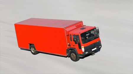 vivid bright red truck on road at high speed isolated - shot from top  photo