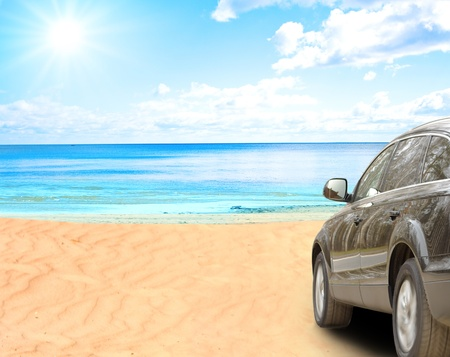 luxury travel: Suv car on a beach Stock Photo