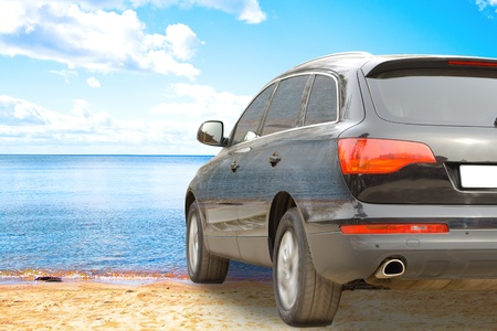 Suv car on a beach Stock Photo