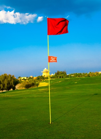 putter: Golf Flag Spread On The Wind