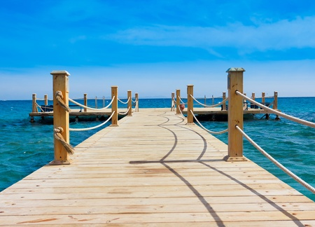Pier in Heavenly Blue Place  Stock Photo