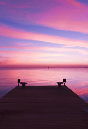 cloudscapes: Pier over Sunset Waters  Stock Photo