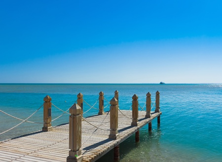 wooden dock: Pier in Heavenly Blue Place  Stock Photo