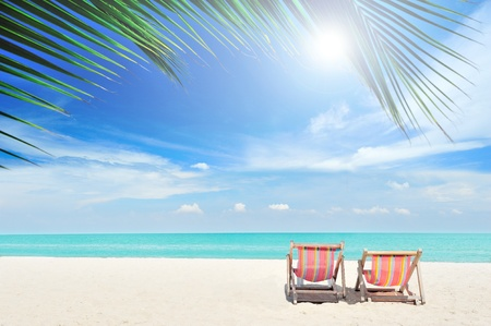 Beach chairs on the white sand beach with cloudy blue sky Stock Photo - 13056328