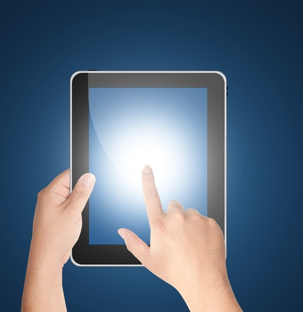 Finger pointing at tablet PC isolated on blue background Stock Photo