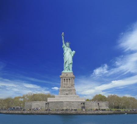 Front view of Statue of Liberty with cloudy blue sky in background