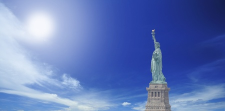 Side view of Statue of Liberty with cloudy blue sky