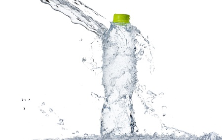 Water splash at bottle with green cap, shallow depth of field