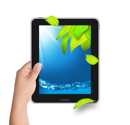 Hand holding tablet PC with falling leaves and water on screen Stock Photo