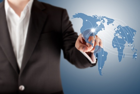 Business man touching world map screen for connectivity concept