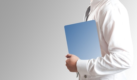 Business man holding tablet PC with blank blue screen