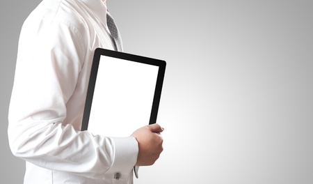 Business man holding tablet PC with blank white screen