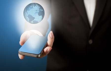 Business man showing smart phone with glowing globe