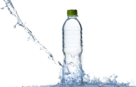 Water splash with bottle and green cap isolated on white background