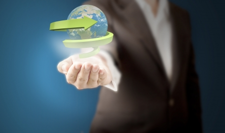Business man showing Realistic globe with spiral green arrow for recycle and eco concept  Elements of this image furnished by NASA
