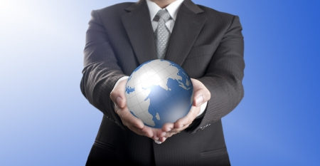 Business man holding digital globe