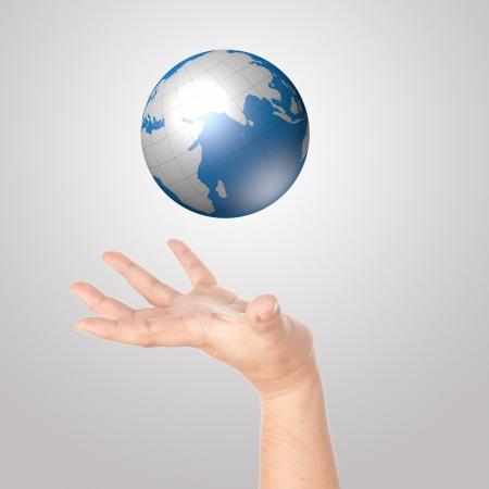 Hand showing digital globe
