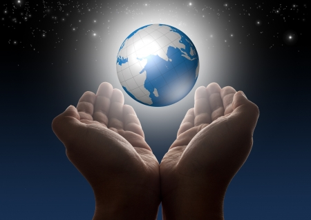 Hands holding glowing digital globe with stars and night sky