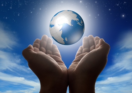 Hands holding glowing digital globe with stars cloudy sky