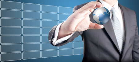 Business man showing digital globe with touch screen icons in background Stock Photo