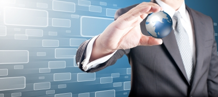 Business man showing digital globe with moving touch screen icons in background Stock Photo