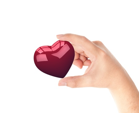 Hand holding red heart isolated on white background