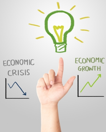 and pointing to the hand draw light bulb with falling and rising graph for economic crisis or growth concept Stock Photo