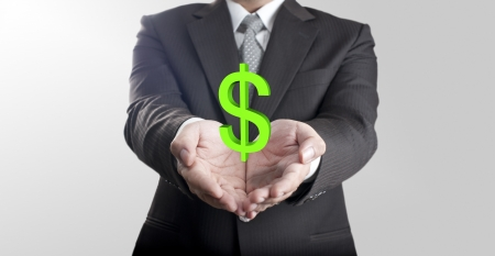 Business man showing green dollar currency sign