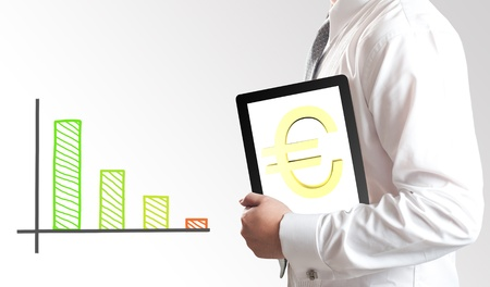 Business man holding tablet PC with Euro currency sign on screen with bar chart in background  Concept for Europe economic crisis  Stock Photo