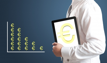 Business man holding tablet PC with Euro currency sign on screen with Euro currency chart in background  Concept for Europe economic crisis  Stock Photo