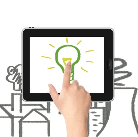 Hand pointing to the hand draw green light bulb on tablet PC screen with factories and Nuclear plant pollution  Concept for eco and global warming Stock Photo