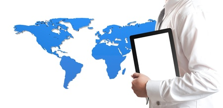 Business man holding tablet PC with world map in background