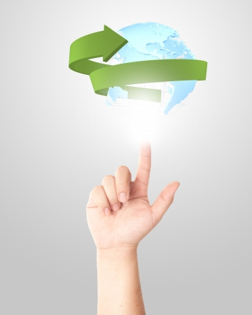 Finger touching glowing digital globe with green arrow surrounding  Concept for social and internet connectivity