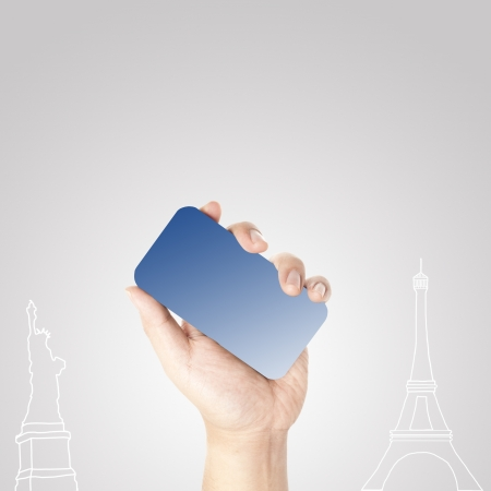 Man s hand holding on the touch screen mobile phone with hand draw of Statue of Liberty and Eiffel tower  Concept for traveling  photo