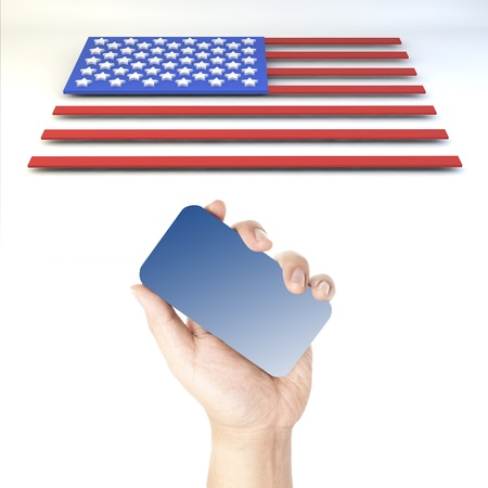 Hand holding smart phone with blank blue screen and USA flag block style in background Stock Photo