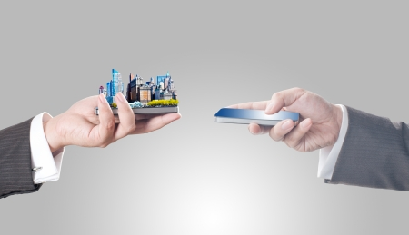 global city: Business men holding smart phone with city on screen for business trading concept Stock Photo
