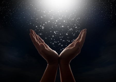 Star falling from the dark night sky to hands Stock Photo