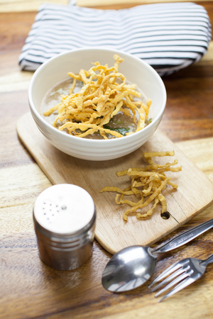 fried noodle: Fried noodle in Gravy on wooden background