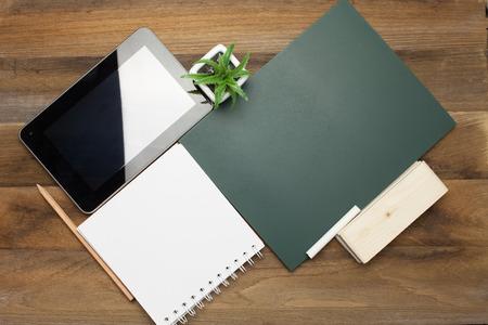 chalk eraser: Tablet,Colorful Chalks,pencil,plant,book,Chalk board and eraser on wooden background