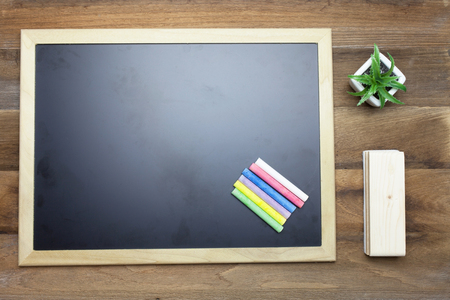 chalk eraser: Colorful Chalks,Chalk board,book and eraser on wooden background Stock Photo