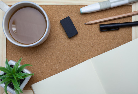 pencil plant: Plant,Pen,book,pencil and coffee on cork board background