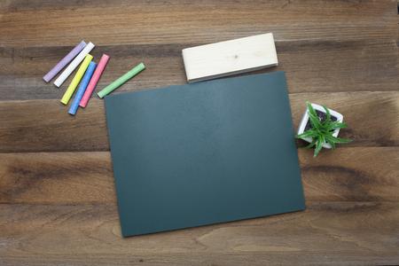 chalk eraser: Tablet,Colorful Chalks,Chalk board and eraser on wooden background