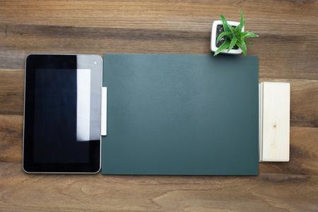 chalk eraser: Tablet,Chalk,Chalk board and eraser on wooden background Stock Photo