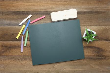 chalk eraser: Colorful Chalks,Chalk board and eraser on wooden background