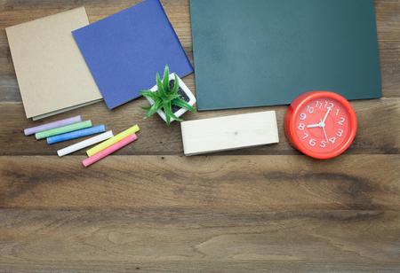 chalk eraser: Red clock,Colorful Chalks,Chalk board,book and eraser on wooden background